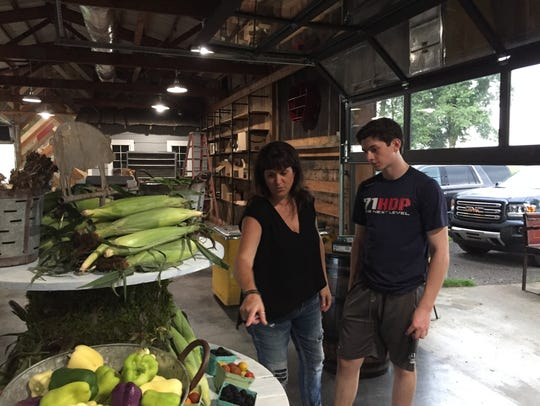 Co-owner Wendy Dorfman, left, and son Braiden, work