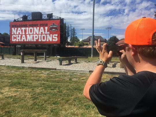 A fan takes a photo of a sign on the Oregon State University