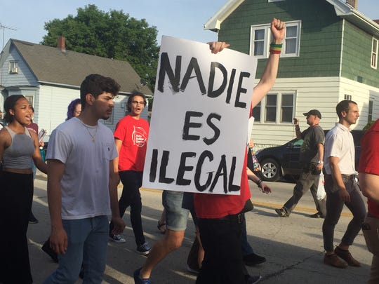 "Protestors marched down National Avenue in Walker's Point to voice concerns about separation of immigrant families at US boarders and call on Anselmo Villarreal, CEO of La Casa de Esperanza, to resign from the board of Southwest Key. The sign carried by a marcher says ""no one is illegal"" in Spanish."