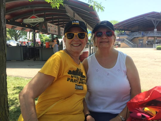 Barbara Cooley (left) and Natalie Longworth enjoy a hot day at Summerfest in the shade.