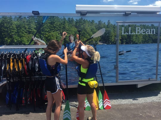 Lily Berlett (right) shows reporter Elena Weissmann how to adjust her paddle so that it was the right height.