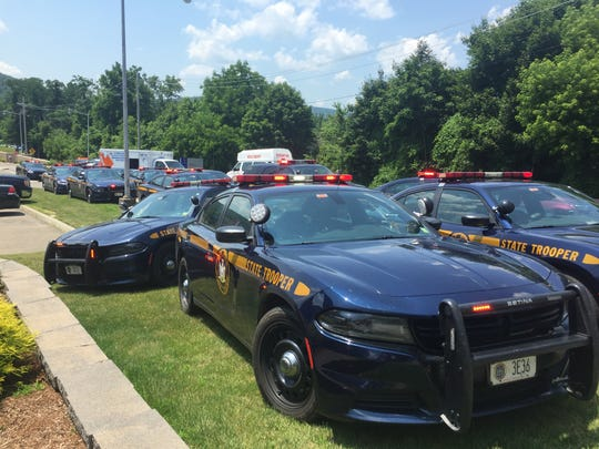 New York State Police Troopers' vehicles converged at Lourdes Hospital in Binghamton Monday after a trooper was killed near Corning.