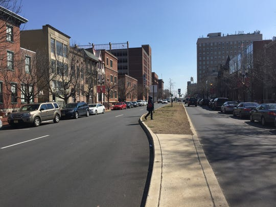 A median strip on Cooper Street in Camden will be replaced with a fence, blocking jaywalkers and creating more traffic lanes.