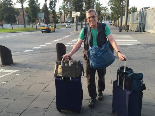 Tim Callahan, in Barcelona, Spain, shows the luggage