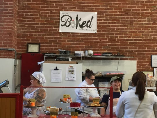 Baked serves customers during its grand opening on