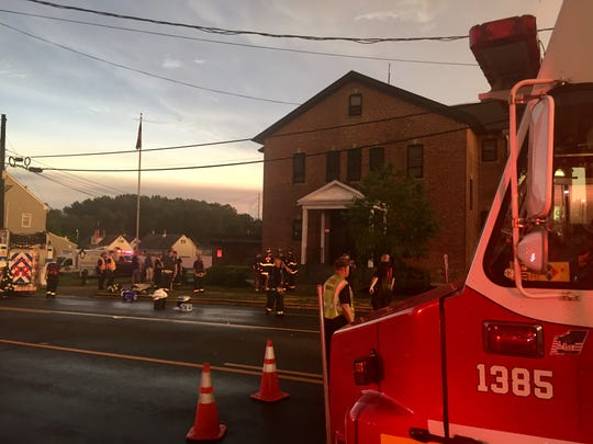 Firefighters responded in a thunderstorm Tuesday evening to a fire at Ethel M. Burke Elementary School in Bellmawr.