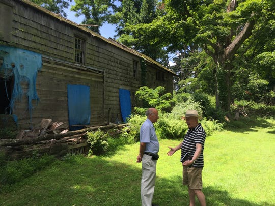 Greenburgh Supervisor Paul Feiner and Robert Stackpole discuss work needed to save the historic Odell House in Hartsdale.