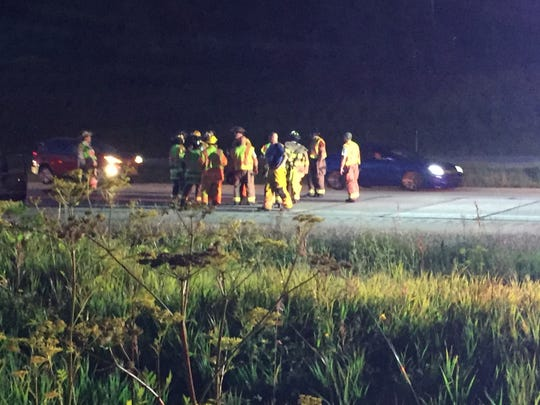 Firefighters and accident investigators work at the scene of a fatal crash Sunday evening that resulted in the southbound lanes of I-41 being closed for nearly three hours near Slinger in Washington County.