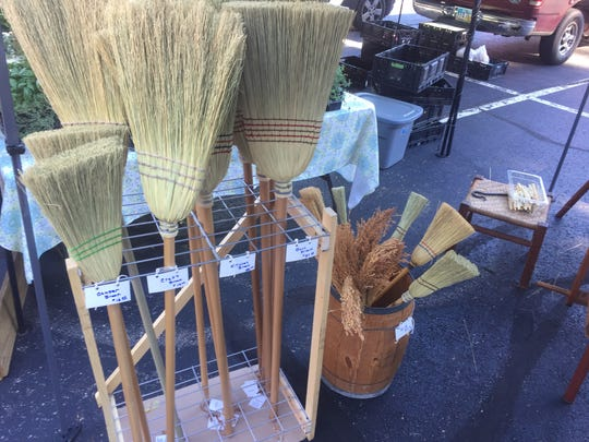 Some of many brooms crafted by Gary Rudolph.