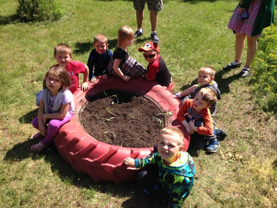 St. John Lutheran students plant pumpkins that they