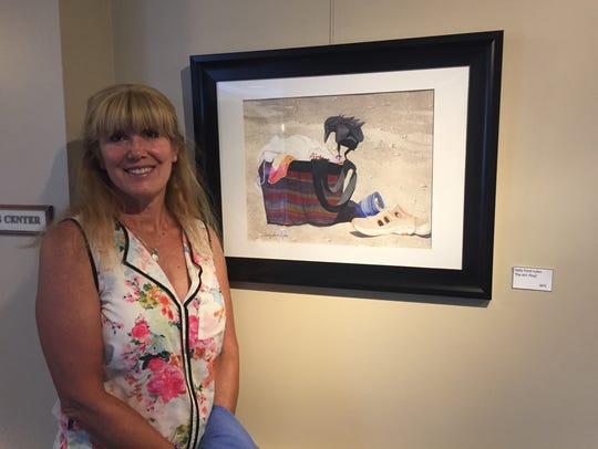 "Artist Sally Ford-Lyles with her work, ""The Art Thief."""