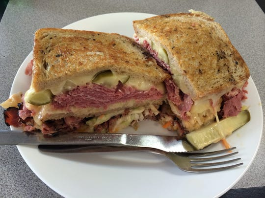 The triple-deck Reuben at Newman's Deli is built with rye bread, corned beef, pastrami, Swiss and cheddar cheeses, coleslaw, sauerkraut, Russian dressing and dill pickle pieces.