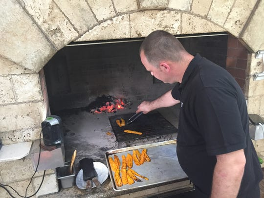 Antonio Selendic, 41, is a chef at Dubrovnik Restaurant. Here, he's grilling vegetables on an outdoor stone grill of the restaurant's patio | Nicholas Tantillo | July 13, 2018