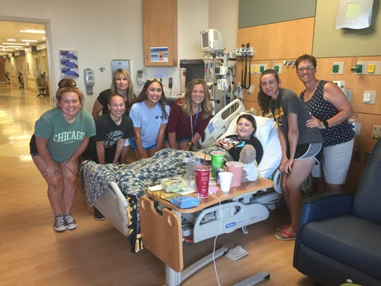 Lauren McGlaughlin is surrounded by friends and family