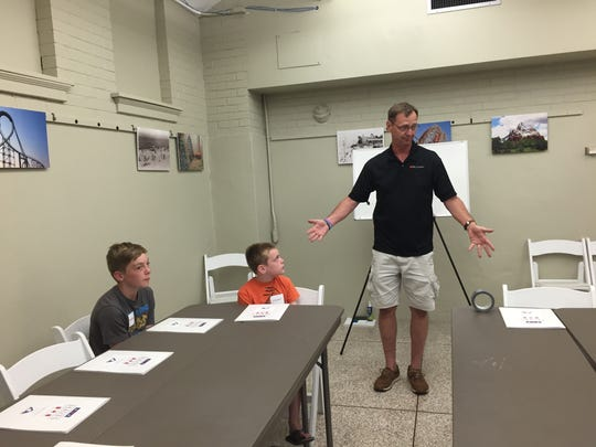 Steve Oberst, a former high school science teacher, kicked off the program at the Hayes Center by explaining some physics basics to the children.