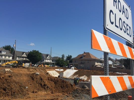 The intersection of Cherry and Grant streets in Palmyra where work is being done by ARM Group on a stormwater project for the borough Wednesday, July 18, 2018. The 300 block of East Cherry Street and the 100 block of South Grant Street have been closed to traffic since 2014, first due to three sinkholes that opened in the area, then for the stormwater project.