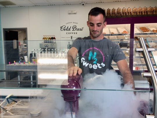 Hunter Conway, manager of N2Sweets, uses liquid nitrogen