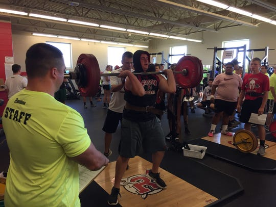 Rocori's Reed Ruegemer practices his weight-lifting