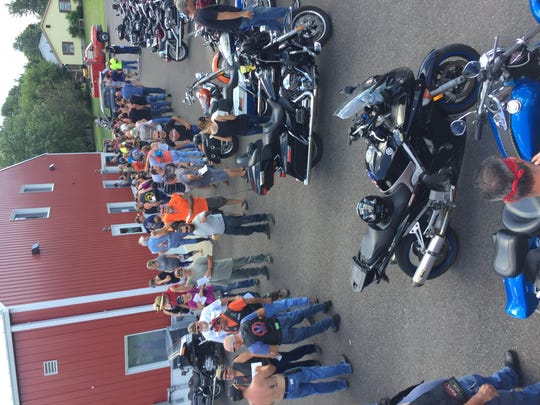 Poker Run participants line up for lunch.