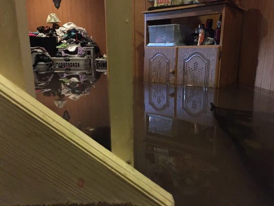The flooded basement of the residence at 138 Julia