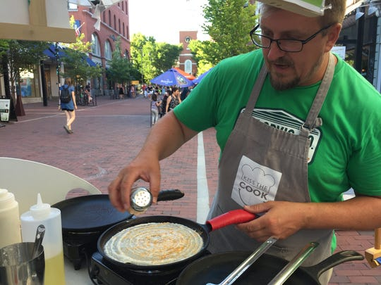 Michael Meehan makes a dosa at the Dosa Love food cart