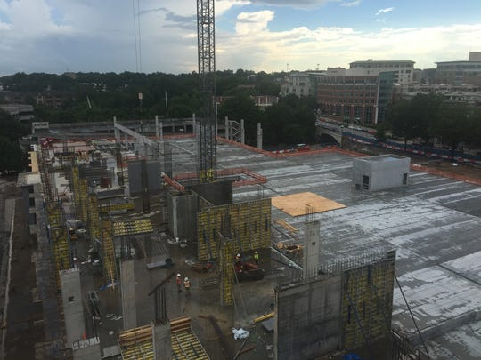 Workers continue construction on the Camperdown project
