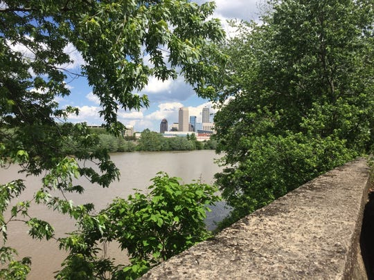 The view of Downtown from the White River Trail between