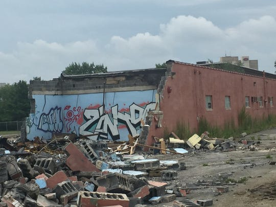 Demolition exposes vandals' graffiti Friday inside