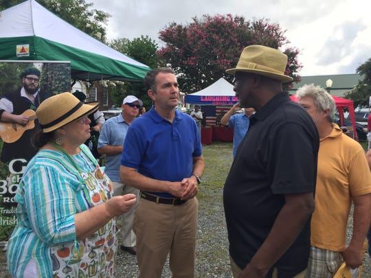 Gov. Ralph Northam chats with Gerald Boyd during a visit to the Onancock Market on Saturday, July 28, 2018.