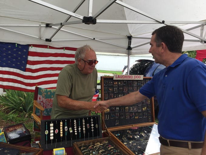 Gov. Ralph Northam chats with vendor Jim Warren during