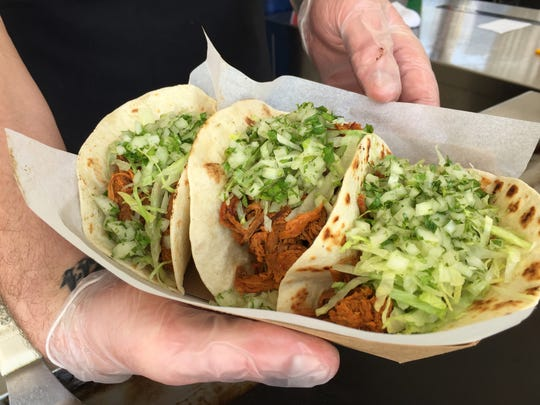 Lamb tacos with lettuce, pico de gallo, sour cream and cilantro at the Lamb Tent in front of Indiana Farmers Coliseum at the 2018 Indiana State Fair.