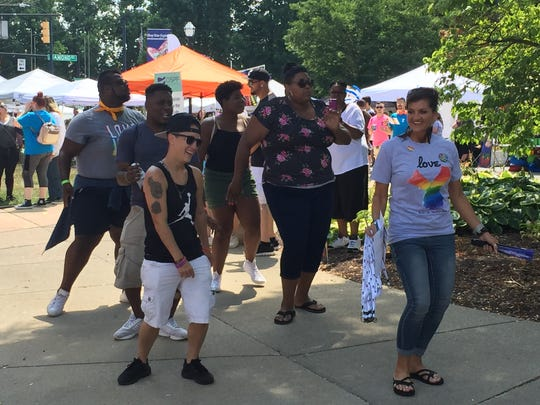 People dance to the music of a disc jockey at the fourth annual Pride Festival in downtown Mansfield.