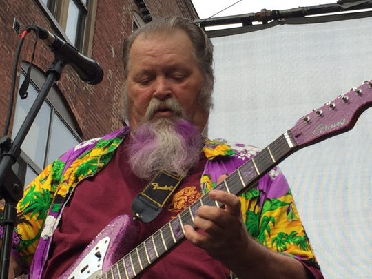 """Big"" Al Lemery, who lives in Essex, plays guitar for"