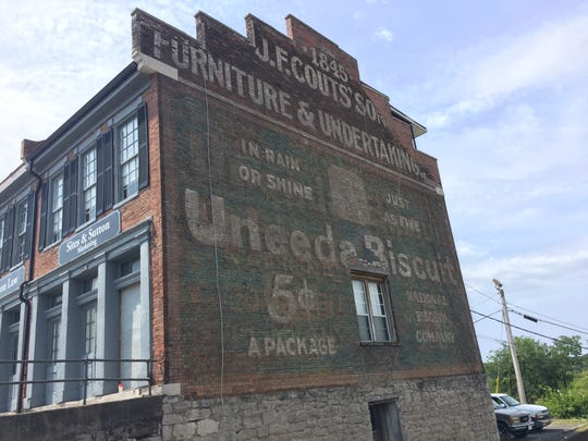 """The oldest advertisement in Clarksville proclaims """"Uneeda Biscuit."""" The National Biscuit Company later became Nabisco."""
