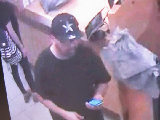El Paso County Sheriff's Office officials are asking for the public's help in locating three suspects accused of stealing a credit card and using it at a department store.