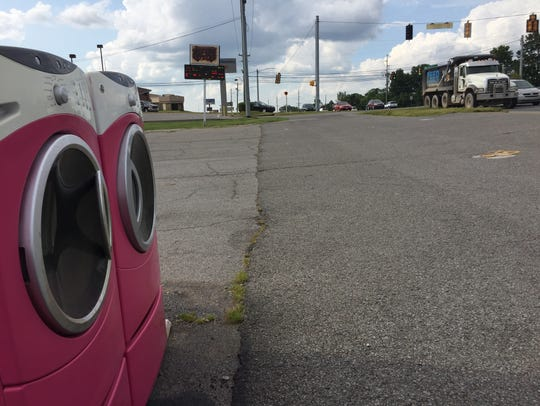 These bright pink washing machines stand sentry along