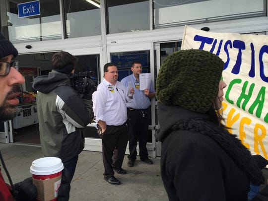 Protesters at the Evendale Walmart were met by store manager Ryan Curtis at the entrance.