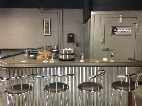 A counter at Planetary Brewing Co. in Greenwood provides space to sit and drink beer.