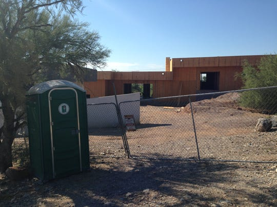 A home near 32nd Street and San Miguel Avenue sits unfinished in a Phoenix neighborhood.