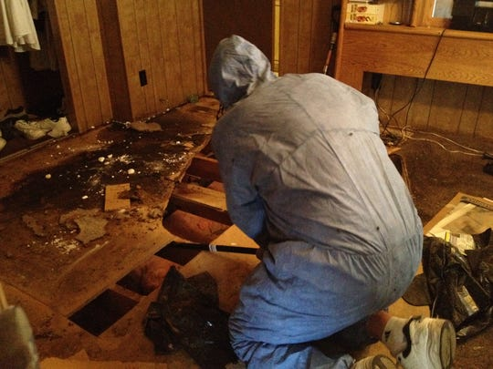 Biopro LLC owner Dale Cillian works on decontaminating the inside of a Scottsdale mobile home this summer after a body was discovered there. Dale Cillian cleans the inside of a mobile home this summer where a body was discovered.