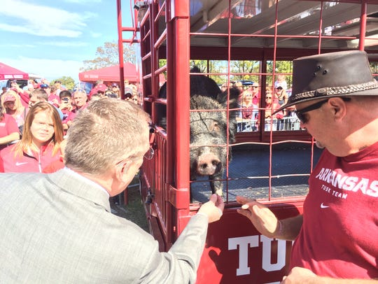 Jeff Long and Tusk IV, Arkansas' live mascot.