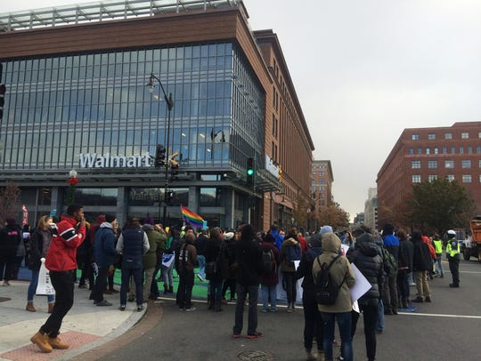 A crowd of more than 100 protested outside of the Walmart
