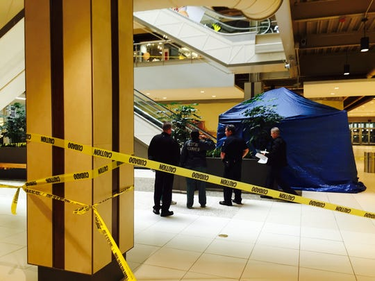 Clarkstown police and Palisades Center personnel talk with an investigator from the Rockland Medical Examiner's Office on the first floor about a man who fell to his death from the third-floor escalators