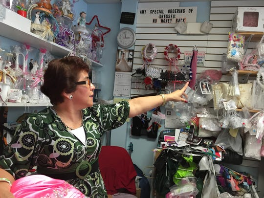 Susana Martinez is the  owner of a dress boutique and tailoring shop on North Race Street in Georgetown.
