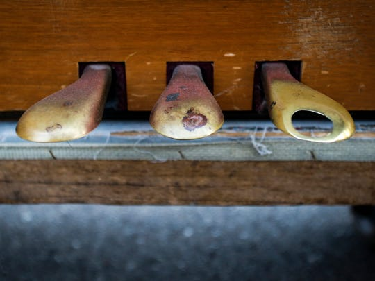 A worn foot pedal on the old Howard piano purchased