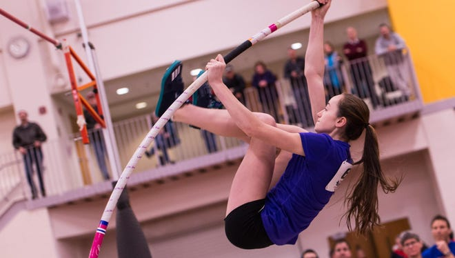Erica Ellis of Gates Chili High School makes an attempt to clear the bar.