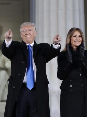 Donald Trump and his wife, Melania, arrive at a pre-inaugural celebration Thursday.