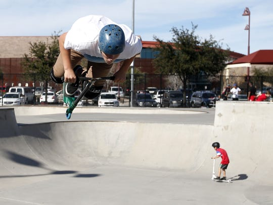 Anthony Zapata, 14, of Phoenix, flips over with his scooter at the skate park at Rio Vista Community Park in Peoria.
