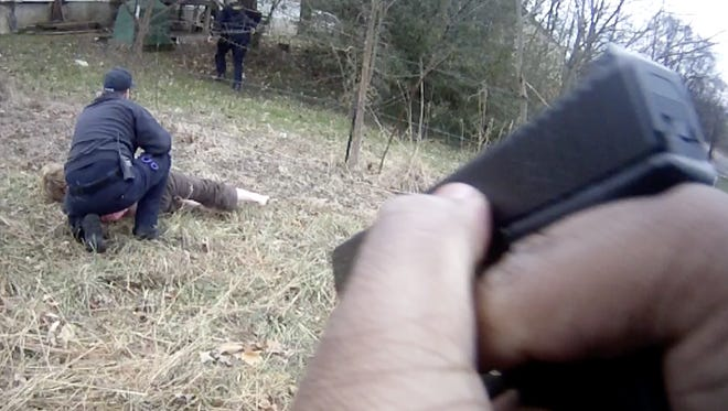 Sevier County Sheriff's Office Deputy Justin Johnson opened fire in a mobile home park, had an apparent panic attack four minutes later, and was forcibly disarmed by a paramedic, body camera footage shows.