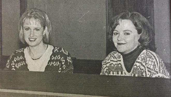 Stephanie Baird, left, and Mary Whitledge were ready to serve customers at the new Kentucky Farm Bureau office opening in January 2000.